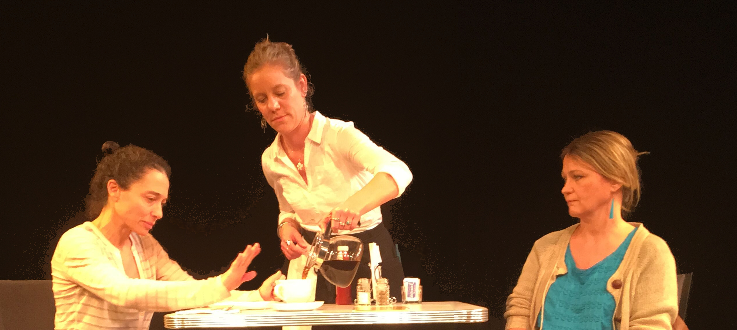 'Two Mothers at a Roadside Café' opens